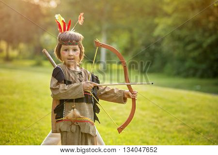 Cute Portrait Of Native American Boy With Costumes, Playing Outdoor In The Park