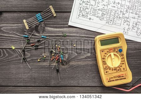 misc electronic components on wooden rustic background poster