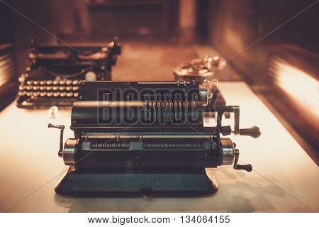 Old mechanical manual counting machine for arithmetical calculations.