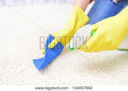 Carpet Cleaning spray. Close-up. Focus on a washcloth and carpet.