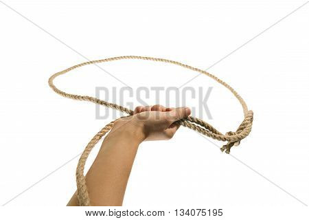 The hand throws a lasso on white isolated background