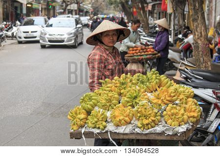 Hanoi Vietnam: February 20 2016: Woman selling Buddha's hand Lemons in a street of Hanoi