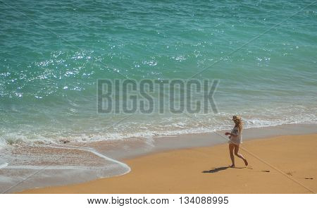 ARMACAO DE PERA PORTUGAL -MAY 18: A view of a running girl on the coast Algarve near city Armação de Pêra in the south of the country Portugal 2016