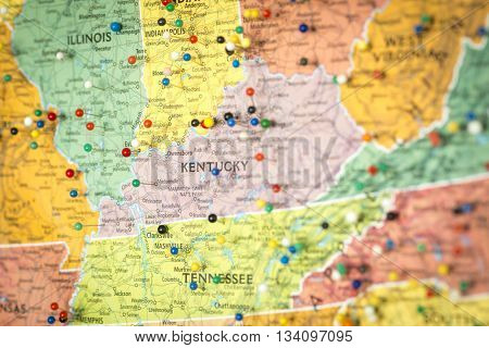 Colorful detail map macro close up with push pins marking locations throughout the United States of America KY Kentucky