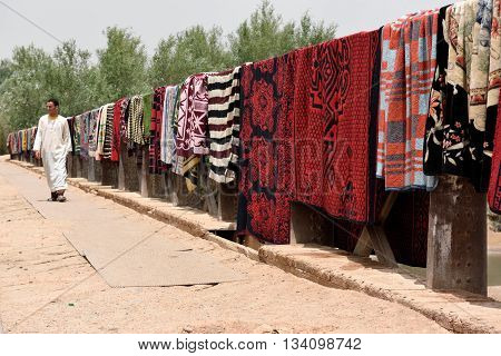 MOROCCO - AUGUST 02: Traditional berber carpets drying in open air in Morocco August 02 2015. Morocco is one of the most popular tourist place in North Africa.