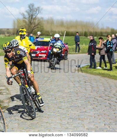 Hornaing, France - April 10,2016: The French cyclist Sylvain Chavanel of Direct Energie Team riding in the peloton on a paved road in Hornaing France during Paris Roubaix on 10 April 2016.