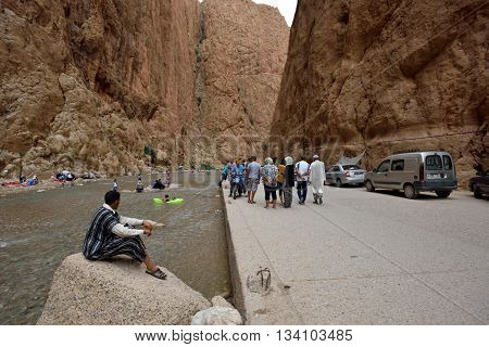 TODRA MOROCCO - AUGUST 02: Unidentified people in a canyon in Morocco August 02 2015. Todra Gorge is a canyon in the High Atlas Mountains in Morocco near the town of Tinerhir.