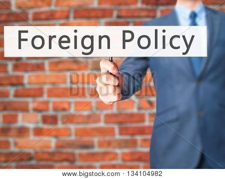 Foreign Policy - Businessman Hand Holding Sign