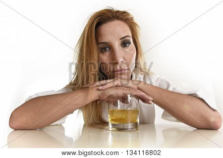 caucasian blond wasted and depressed alcoholic woman drinking scotch whiskey glass looking desperate isolated on white in alcohol abuse and addiction and housewife alcoholism problem poster