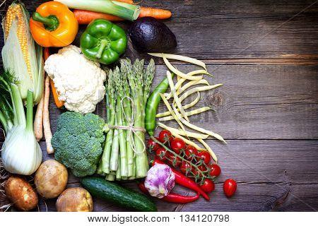 Fresh vegetables on a vintage wooden background