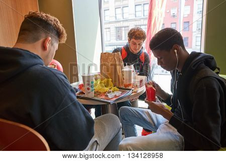 NEW YORK - CIRCA MARCH, 2016: customers in McDonald's restaurant. McDonald's is the world's largest chain of hamburger fast food restaurants, founded in the United States.