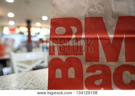 NEW YORK - CIRCA MARCH, 2016: close up shot of paper bag with food from McDonald's restaurant. McDonald's is the world's largest chain of hamburger fast food restaurants, founded in the United States.