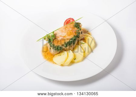 Meat cutlets with potato garnish on white plate