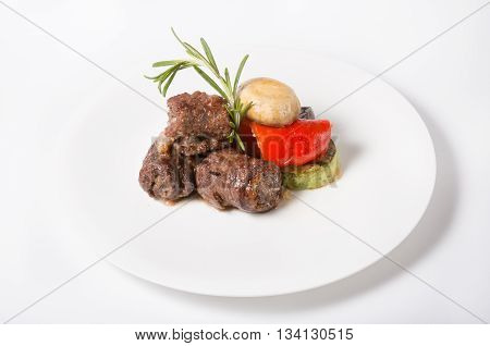 Prepared beef or lamb meat in kebab style with grilled vegetables