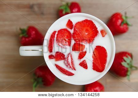Ceramic Cup of Milk,Red Fresh Strawberries on the Wooden Background.Breakfast Organic Healthy Tasty Food.Cooking Vitamins Ingredients.Summer Fruits.Selective Focus,Top View