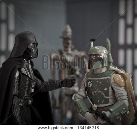 BLOOMFIELD NJ - JUNE 12 2016: Recreation of a scene from Star Wars The Empire Strikes Back where Darth Vader instructs bounty hunter Boba Fett that he wants Han Solo alive with No Disintegrations.
