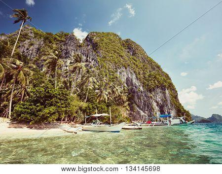 Boats at El Nido bay. Palawan island, Philippines. Instagram styled
