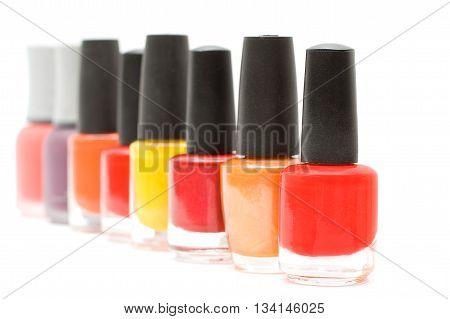 Nail Polish Isolated on white. Red, Yellow, Orange.