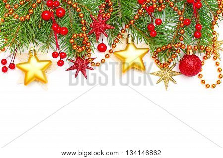 Christmas concept - Xmas tree branch and decoration isolated on white