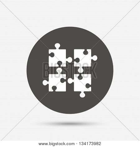 Puzzles pieces sign icon. Strategy symbol. Ingenuity test game. Gray circle button with icon. Vector
