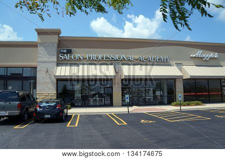 SHOREWOOD, ILLINOIS / UNITED STATES - AUGUST 16, 2015: The Salon Professional Academy offers programs in cosmetology, in a Shorewood strip mall.
