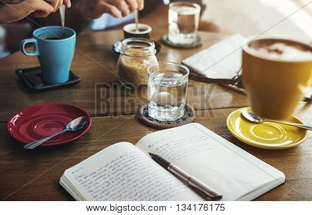 Coffee Shop Drinking Coffee Notebook Concept