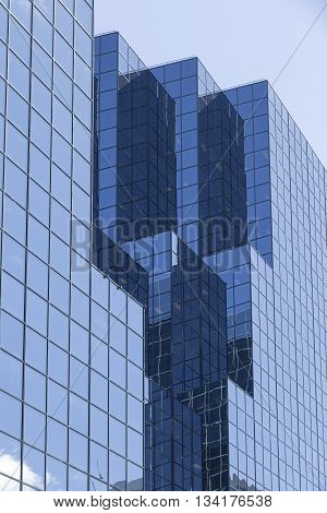 Glass building facade on a bright sunny day