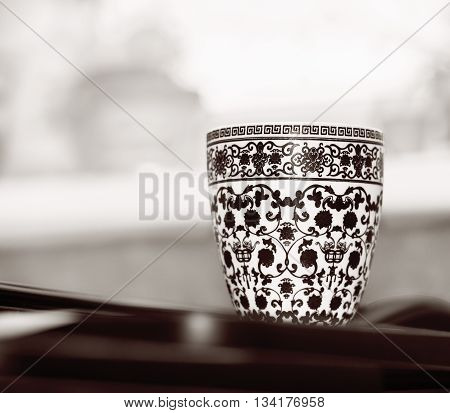 Close view of ornamented tea cup in black white