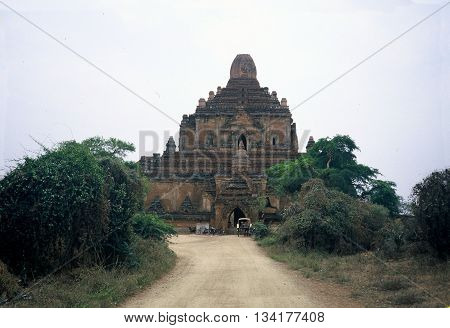 PAGAN BURMA (NOW CALLED MYANMAR) - CIRCA 1987: People visit the ancient Htilominlo Temple in Pagan via bicycle and horse-drawn carriage.