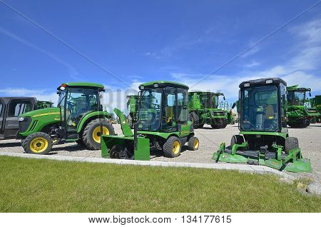 MOORHEAD, MINNESOTA, June 6, 2016: The new diesel tractor, combines,  lawn tractor, and snow blower  are products of John Deere Co, an American corporation that manufactures agricultural, construction, forestry machinery, diesel engines, and drivetrains.