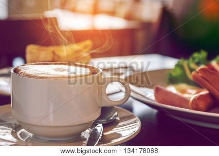 Closeup Of Coffee Cup With A Breakfast At Coffee Shop