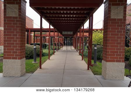 PLAINFIELD, ILLINOIS / UNITED STATES - OCTOBER 5, 2015: A covered walkway connects buildings at the Adventist Plainfield Medical Campus in Plainfield.
