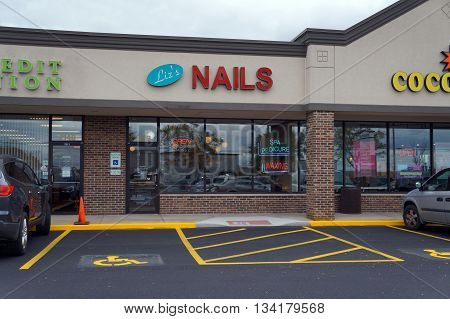 JOLIET, ILLINOIS / UNITED STATES - OCTOBER 9, 2015: One may have one's nails trimmed at Liz's Nails, in the Crossroads Plaza.