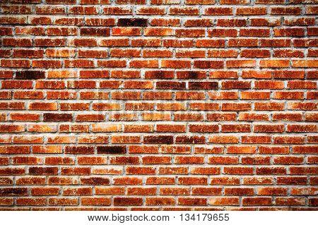 Background of orange brick wall pattern texture.