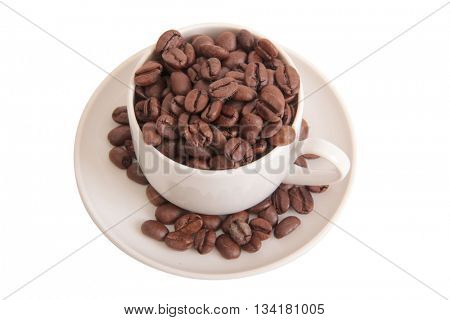 Coffee beans and cup on white background