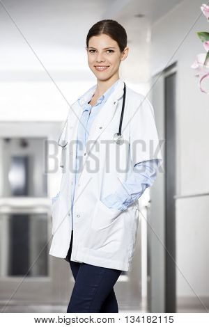 Smiling Doctor With Hands In Pockets At Rehab Center