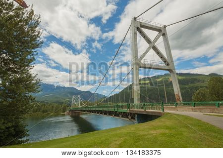 Majestic Columbia River Bridge (Revelstoke Bridge) surrounded by mountains.