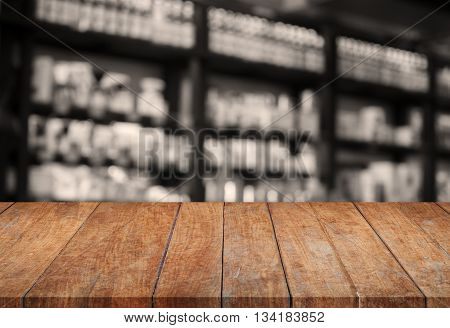 Wooden tabletop with sepia blurred background, stock photo