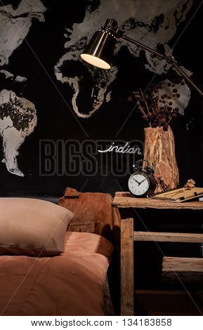 Brown color scheme bedding with industrial style table lamp
