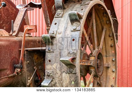 Close-up of the steel wheel of an old tractor