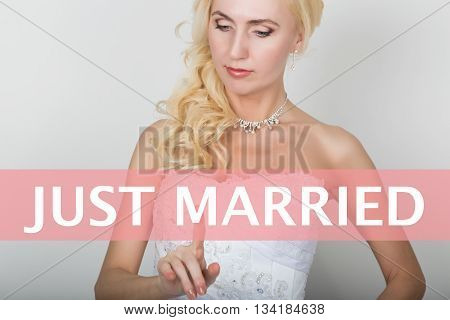 technology, internet and networking concept. Beautiful bride in fashion wedding dress. Bride presses just married button on virtual screens.
