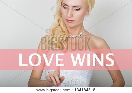 technology, internet and networking concept. Beautiful bride in fashion wedding dress. Bride presses love wins button on virtual screens.