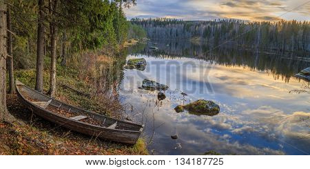 boat with river and forest and mountains