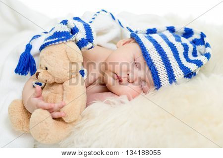 sleeping beautiful baby infant girl with teddy bear
