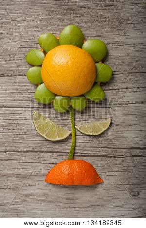 Flower made of fruits on wooden background