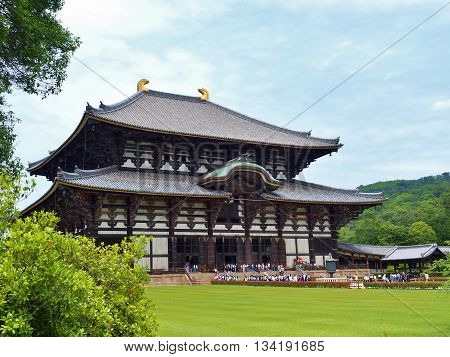 NARA, JAPAN - JUNE 6, 2016: The Great Buddha Hall at Todai-ji temple in Nara, Japan. That Hall is house of the world's largest bronze statue of Daibutsu. The temple is an UNESCO World Heritage Site.