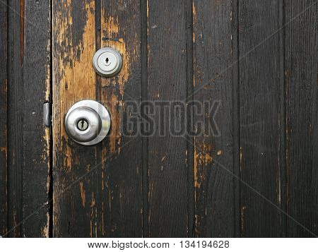 Old door knob Wooden door Textured surface