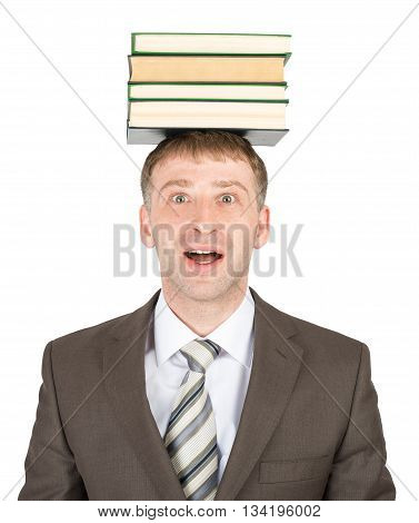 Young man holding stack of books isolated on white background