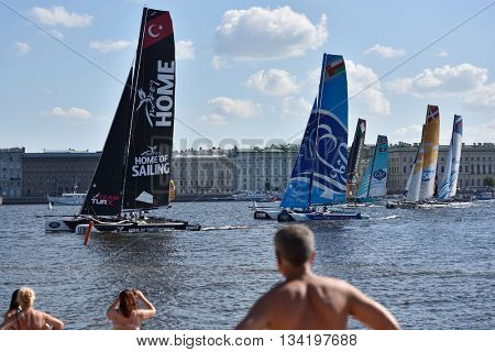 ST. PETERSBURG, RUSSIA - AUGUST 23, 2015: People on the beach watching races of Extreme 40 catamarans during St. Petersburg stage of Extreme Sailing Series