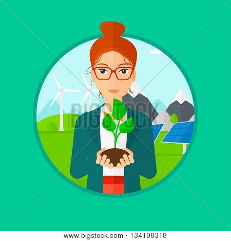 Woman holding in hands green small plant in soil. Woman with plant in hands on a background with solar pannels and wind turbins. Vector flat design illustration in the circle isolated on background.